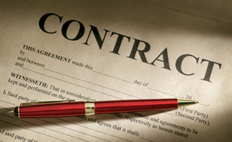 Printed contract and pen