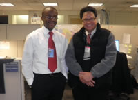 Jonathan Bashi at his UN office in New York with Boyet Caparas