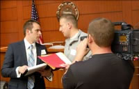 Photo of students being filmed for a documentary in the courtroom