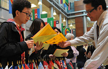 Students read flyers at Pro-Bono fair in Inlow Hall Atrium